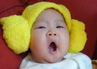 baby with a bright yellow hat.jpg