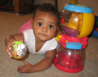 Baby girl playing with her toys in full colors.PNG