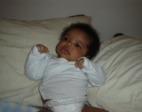 Black baby in white.PNG