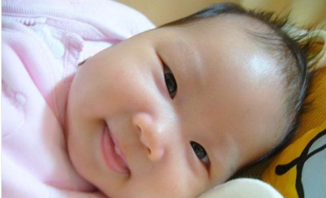 big close up photo of Asian baby girl face.jpg