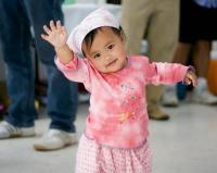 cute Asian baby girl saying hello to you.jpg