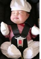 cute Asian baby in baby chair.jpg