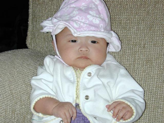 cute Asian baby with her pink hat.jpg