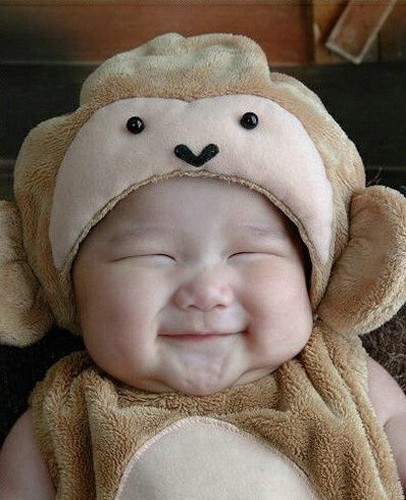 Picture of adorable smiling baby in teddy bear outfitPictures Of Cute Babies Smiling