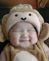 Cute smiling baby in teddy bear outfit.jpg