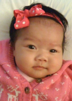 Asian baby girl in pink with her cute headband.PNG