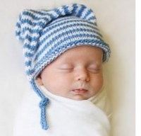 Cute baby boy with blue hat with white stripes.PNG