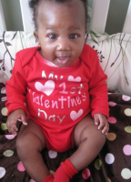 Black baby in valentines  outfit.PNG