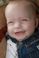 Baby smiling with eyes closed.PNG