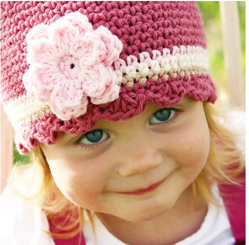 Beautiful girl toddler with floral hat.PNG