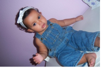 Picture on beautiful baby girl in jeans.PNG