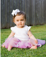 Ballet dancer baby girl in purple dress with white headband.PNG