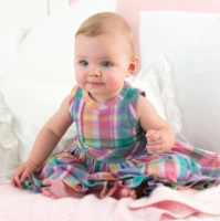 Beautiful baby girl in multi color dress looking so adorable.PNG