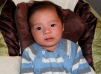 Cute asian baby boy picture looking straight at the camera.PNG