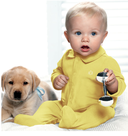 Beautiful baby boy in yellow with his pup.PNG