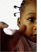 close up picture of a cute black baby girl.jpg