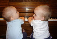 Twin baby brothers playing piano_they look so sweet.PNG