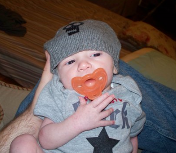 Adorable baby boy picture wearing a cool grey hat.PNG