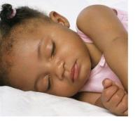 pretty african american baby in pink sleepying.jpg